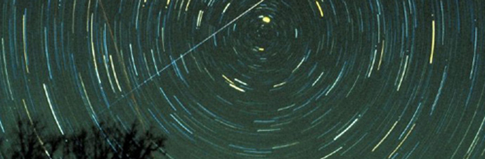 Star trails and a Geminid meteor over Brasstown Bald mountain, Georgia, in 1985. Credit: Jimmy Westlake.