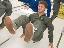 Dan Torczynski floating inside an airplane during a moment of microgravity