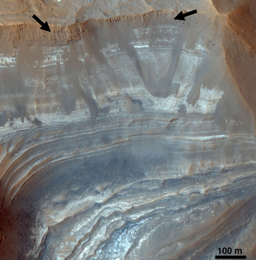 Variation in light-toned deposits in a Martian trough