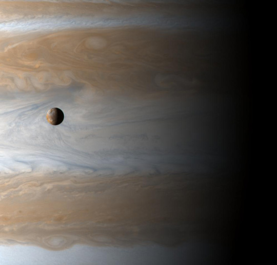 Image showing the Galilean satellite Io floating before the cloudtops of Jupiter