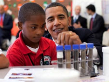 President Obama helps a student with a science experiment in Summer 2009. Credit: White House