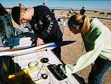 Two students working on a rocket