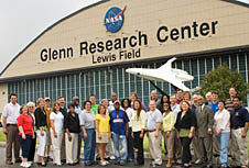 A group photo in front of a hangar at Glenn Research Center's Lewis Field