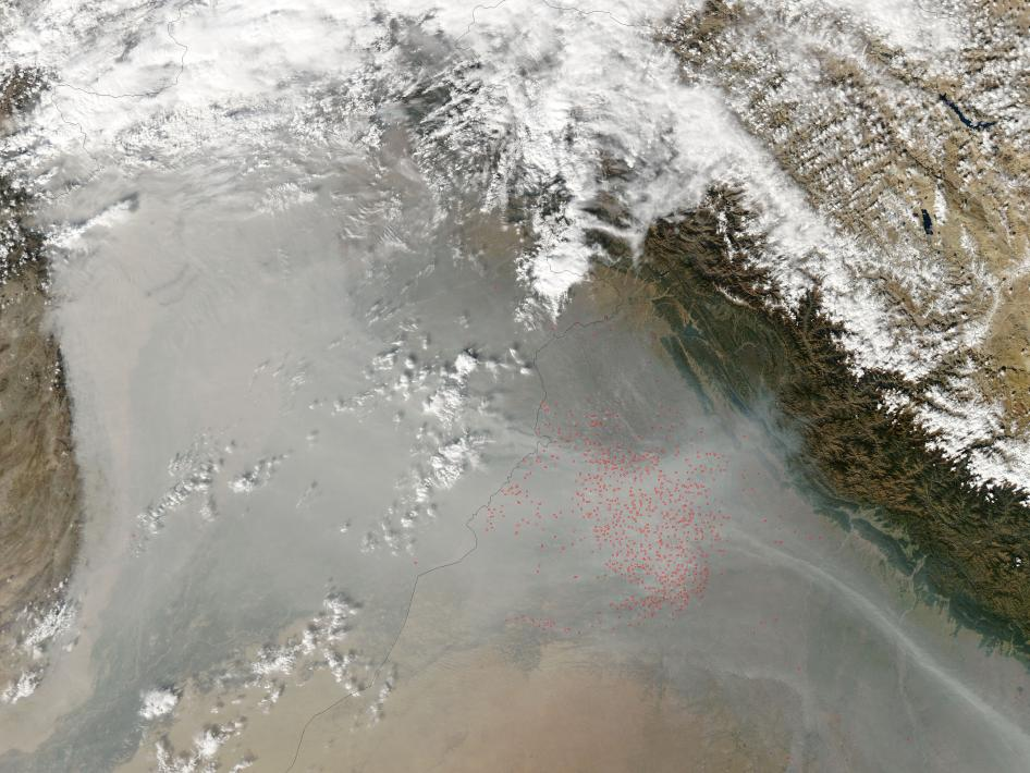 Fires burned in northwestern India near the Pakistan border in early November 2009.