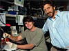 Dennis Murray and JPL mentor and engineer Peter Willis in JPL's Bio-Nano Lab