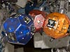 Three bowling-ball-sized, free-flying satellites floating in the space station