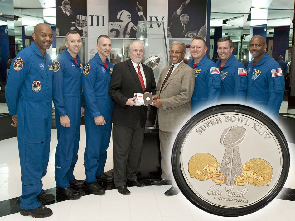 Crew Presents Coin For Super Bowl Coin toss