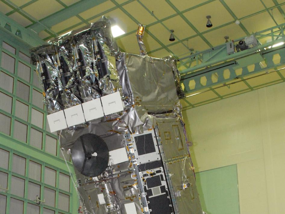 Spacecraft, on ransome table, in the process of being lowered to a horizontal position.