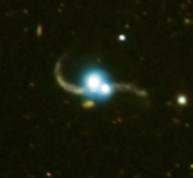 Composite image shows the effects of two galaxies caught in the act of merging.