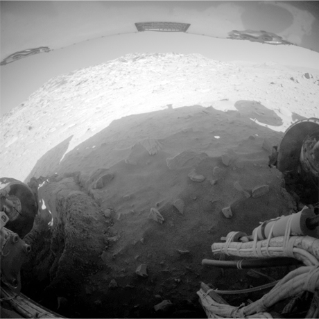 NASA's Mars Exploration Rover Spirit recorded this fisheye view with its rear hazard-avoidance camera