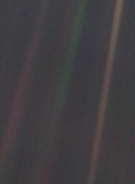 narrow-angle color image of the Earth taken by Voyager 1.