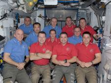A group photo of the crew members of the space station and space shuttle Endeavour.