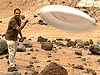 Mars scientist Ashwin Vasavada throws a frisbee