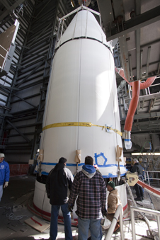 Workers install NASA's GOES-P meteorological satellite onto the Delta IV stages already in place in the mobile service tower at Launch Complex 37 on Cape Canaveral Air Force Station.
