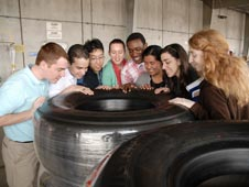 MIT students peer into a Michelin tire used on a space shuttle flight.