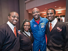 Va. State Univ. students Jaren Kelly, Ta'Keisha Martin and Charles Ramey with astronaut Leland Melvin