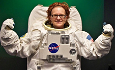 Kristen Ann Edwards wearing a white spacesuit