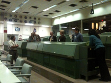 The Group receives instruction on Apollo Mission Control Center from Flight Controller