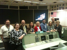 TI and HRPEO team members in Apollo Mission Control Center with Flight Controller