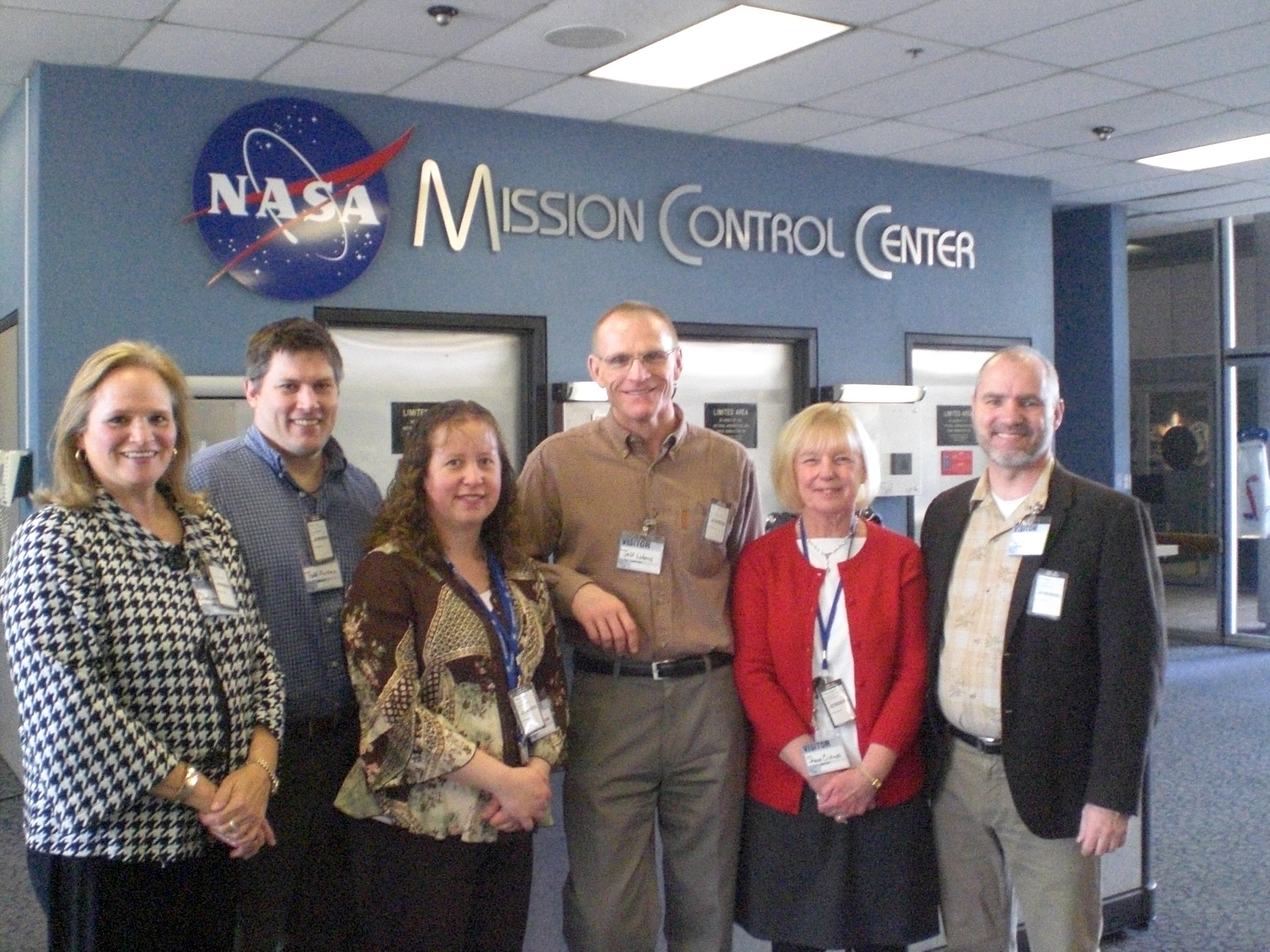 TI Education Manager and Master Instructors pose for a picture before touring the mission control centers at NASA Johnson Space Center
