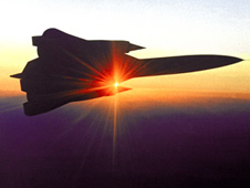 A YF-12 aircraft in flight at sunsest.