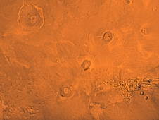 The Tharsis region of Mars, including the three volcanoes of  Tharsis Montes (Arsia, Pavonis and Ascraeus Mons), as well as Olympic  Mons in the upper left corner