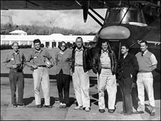 In this photograph Joanne Simpson stands with her crew in front of the Woods Hole aircraft.