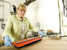 Rhonda Lash, a materials engineer with NASA, prepares the first U.S. sample cartridge for x-ray.