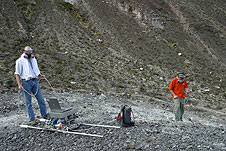 Dr. Tim Griffin and a researcher in a volcano crater.