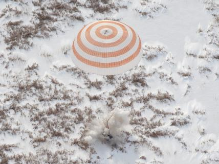 Expedition 22 Crew Lands