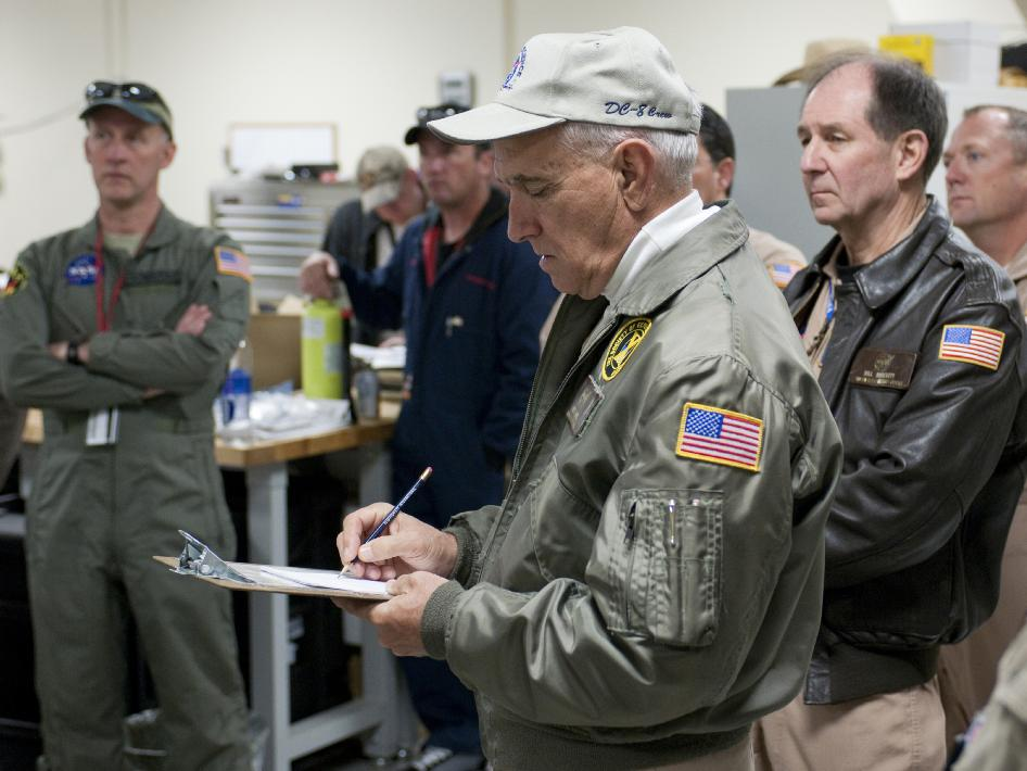 NASA research pilots and crew are briefed prior to an Operation IceBridge