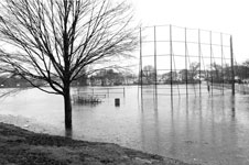 The recent flood waters from Furnace Brook inundated ORourke Field in Quincy, Mass.
