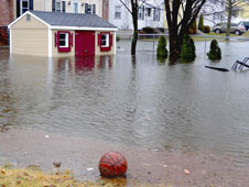 Three days of steady rain in excess of 9 inches filled in backyards, basements, playgrounds, streets and caused widespread flooding.