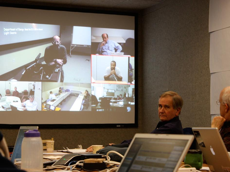 Dale Cruikshank and David Des Marais at NASA Ames Research Center talk to George Cody at the Carnegie Institution of Washington and other videoconferencing rooms at research sites across the country.