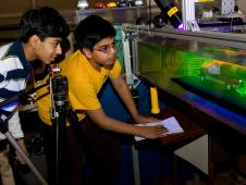 Thirteen-year-old Ajay Ramesh and 12-year-old Prithvi Aiyaswamy,  two seventh grade boys from Chaboya Middle School, San Jose, Calif.,  enjoyed a visit to the Fluid Mechanics Laboratory to learn about  reducing drag with cars