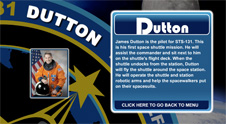A close-up view of the name Dutton on the STS-131 mission patch and a photo of James Dutton