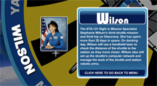 A close-up view of the name Wilson on the STS-131 mission patch and a photo of Stephanie Wilson