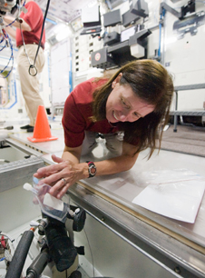 NASA astronaut Shannon Walker, Expedition 24/25 flight engineer, participates in a training session in an International Space Station mock-up/trainer in the Space Vehicle Mock-up Facility at NASA's Johnson Space Center