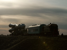 2010003310017hq -- The Soyuz TMA-18 spacecraft is rolled out by train