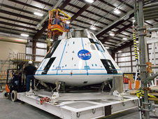 JSC2009-E-227817 -- Technicians work on the crew module