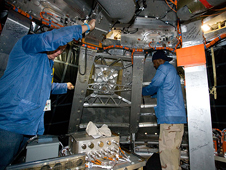 JSC2009-E-241549 -- Technicians work inside the boilerplate crew module