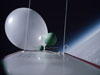 A weather balloon travels high above Earth's surface.