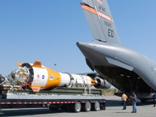 Jumbo dart used as part of the Ares I parachute test is being load into back of a U.S. Air Force C17.