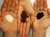 hands holding particulates that can function as aerosols