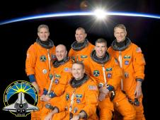 The six crew members of STS-132 pose in orange suits