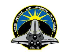 The mission patch features the space shuttle, sun and Earth
