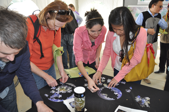 NASA Village guests assemble Earth puzzles
