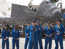 Astronaut Clayton Anderson and the rest of the Discovery crew in front of Discovery after landing.
