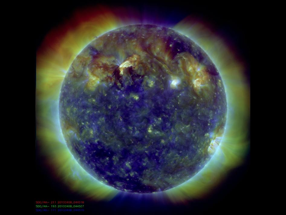 Photo of Sun taken by the SDO spacecraft showing solar flares and their associated magnetic waves traversing the Sun.