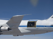 With its primary mirror covered by a protective sun shade, the German-built infrared telescope nestled in the rear fuselage of NASA's SOFIA flying observatory is easily visible in this close-up image taken during a recent test flight.